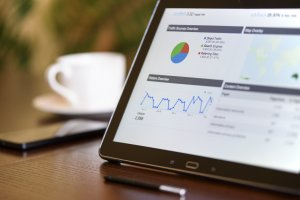 Tablet standing on a desk with Google Search Console open, showing SEO metrics